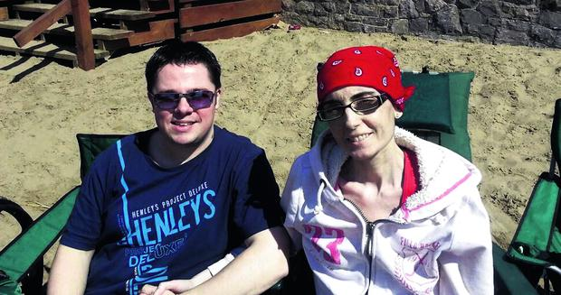 The last picture of Katie Scarbrough on the beach at Weston Super Mare with her husband Stuart