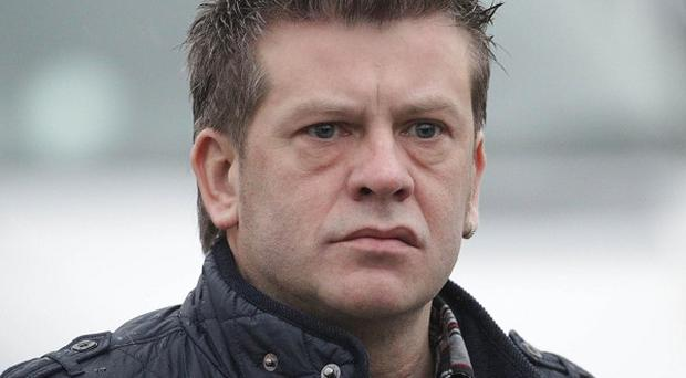 Brian Shivers denies involvement in a fatal gun attack outside Massereene army barracks