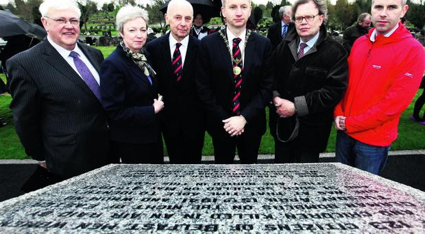 At the refurbished memorial are (l-r) Cllr Tom Haire, Cllr Naomi Thompson, Lt Col CT Hogg, High Sheriff of Belfast Cllr Brian Kingston, Cllr Tom Hartley and Cllr Steven Corr