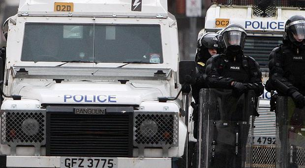 Many police officers were injured and 240 people arrested during protests against the flag decision which turned violent