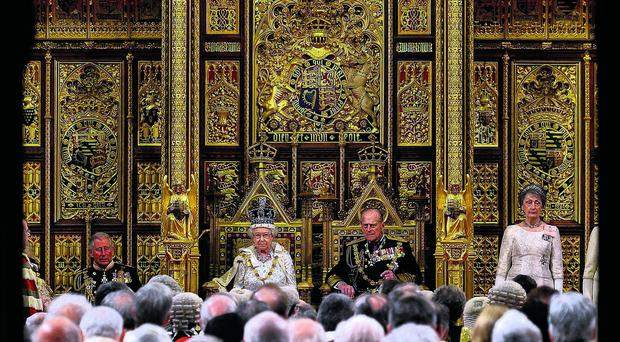 Queen Elizabeth II looks on before delivering her speech during the State Opening of Parliament at the House of Lords