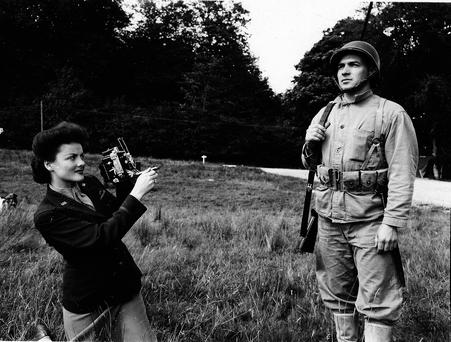 Irish American Hollywood Starlet Peggy Diggins, serving in the US International News Service photographing a US Marine Private James Lines of Orange County, New York at Beech Hill Camp in August 1943