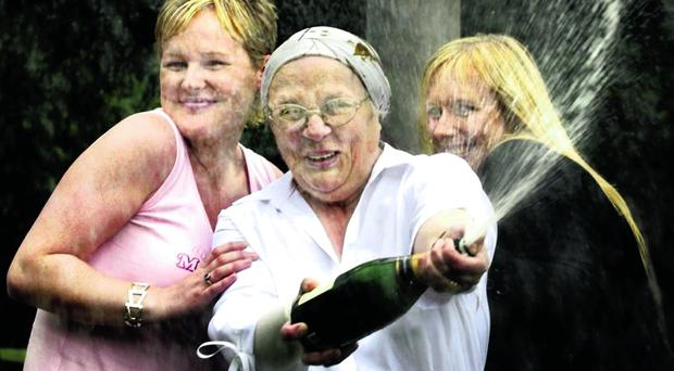 Belfast's £20 million Lottery winner Iris Jeffrey (58) and her two daughters Karen (L) and Wendy (R)