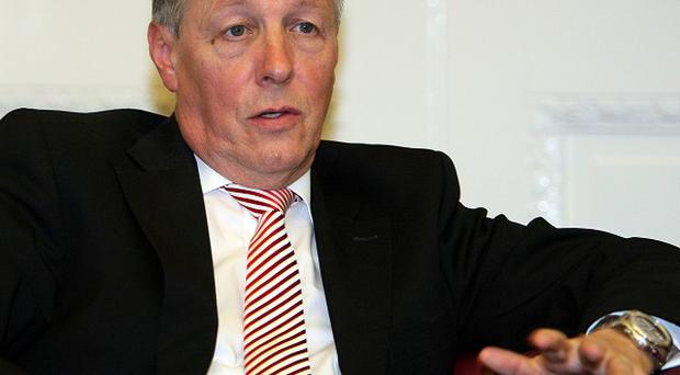 First Minister Peter Robinson has said he is 'fed up' with his opponents' attempts to 'politick and posture'