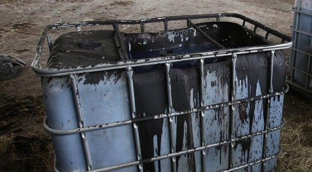 A container of sludge at a fuel laundering plant