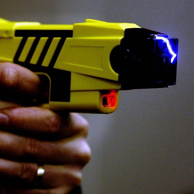 The Taser was deployed to restrain one of the men at the property