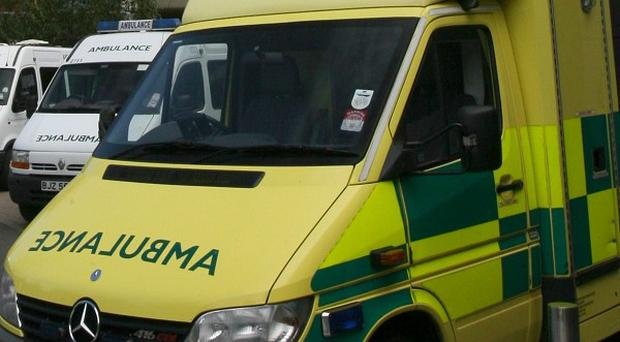 An ambulance has collided with a car at the Westlink in Belfast