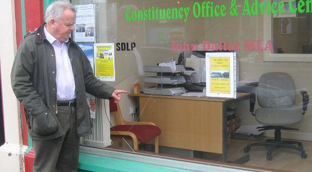 East Derry MLA John Dallat examines damage done to his constituency office in Kilrea (SDLP/PA)