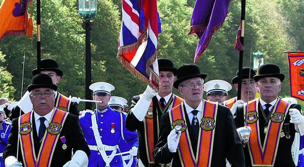 Orange Order members arrive at Stormont
