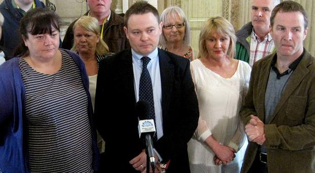 John Loughran, centre, addresses the media alongside other victims' campaigners opposed to the Special Advisers Bill