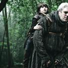 Isaac Hempstead Wright who plays Bran Stark being carried by Kristian Nairn who plays Hodor. Picture: Helen Sloan/HBO