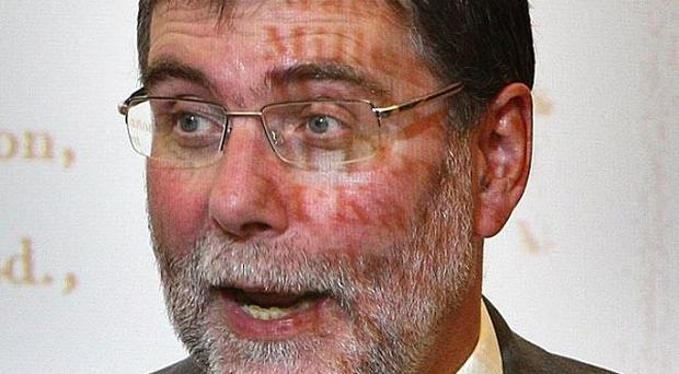 Minister Nelson McCausland said he wondered 'at the level of incompetence within the Housing Executive that led to this state of affairs'
