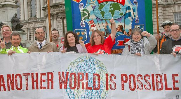 The new banner unveiled for a G8 protest at Belfast City Hall which will lead the Belfast G8 protest on Saturday