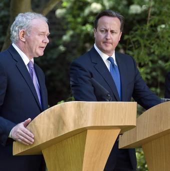 David Cameron announced a stimulus package after meeting Peter Robinson and Martin McGuinness