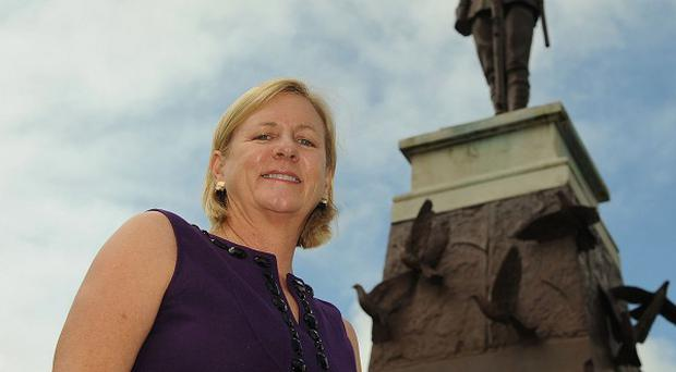 American foreign policy strategist Nancy Soderberg stands by the Enniskillen cenotaph