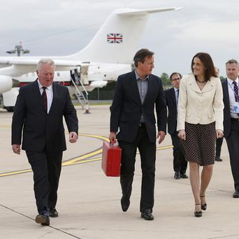 Theresa Villiers (second right) has praised the security forces for their organisation of the G8 summit