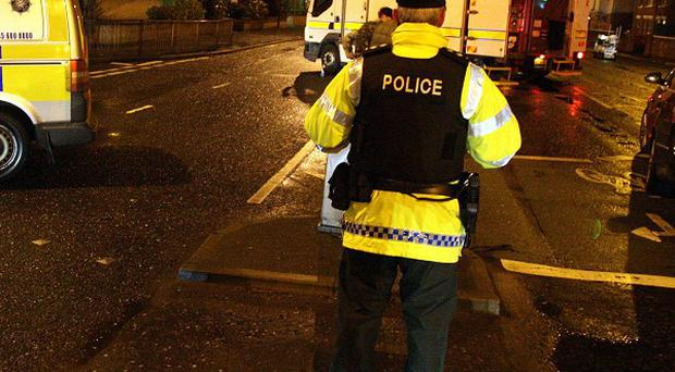 Police sealed off the upper Newtownards Road in Belfast after a booby trap bomb was found under a policeman's car
