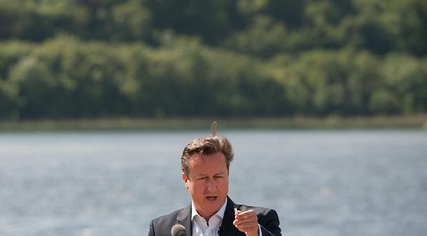 Prime Minister David Cameron holds a press conference at the end of this year's G8 Summit on Lough Erne near Enniskillen