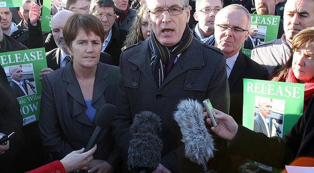 Gerry Kelly (centre) tried to stop a police Land Rover during scuffles in the Peters Hill area