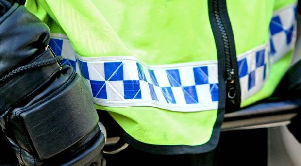 Police have started an investigation after an 84-year-old woman was injured in a street robbery