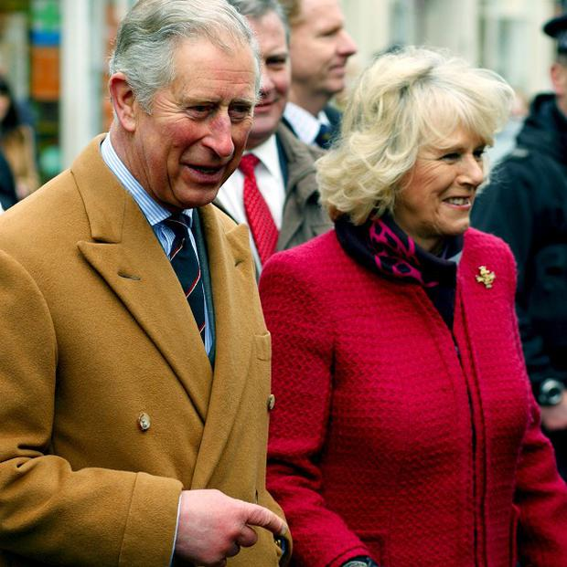 The Prince of Wales and Duchess of Cornwall have toured a Co Antrim factory where new ultra-low carbon double-decker buses are being built
