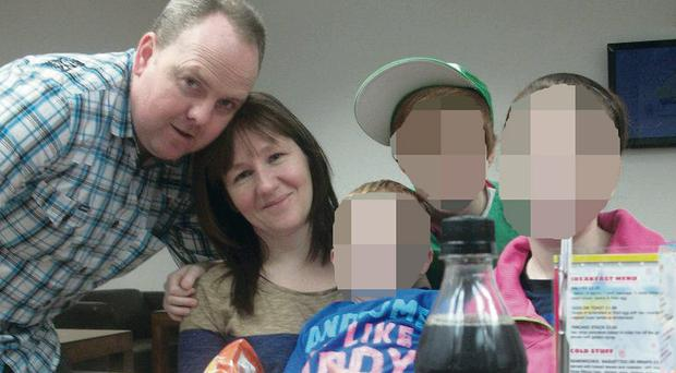 Jamie Stevenson who was savaged by a dog pictured with his Dad Darwin, mum Valerie and Siblings