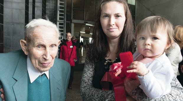 Oldest visitor Alan McKay age 97 former flag boy on the trams at the Giants Causeway with youngest visitor Tegan Carey age 1 with mum Sharon