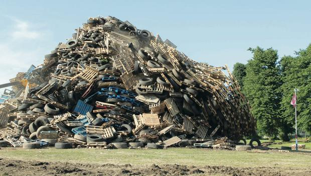 There is to be a tightening of regulations regarding old tyres to prevent bonfires. Above: Ballycraigy bonfire in Antrim 2013
