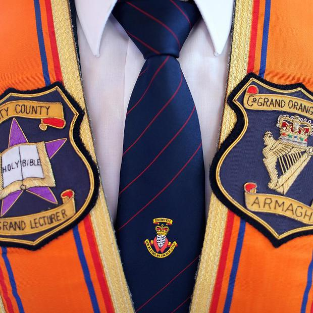 The Orange Order's leader has described restrictions on a march through a north Belfast flashpoint as absurd