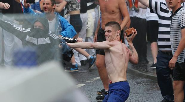 Loyalists confront police in north Belfast, after an Orange July 12 parade was stopped from passing a Nationalist area