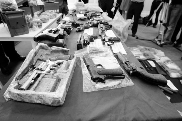 Gardai display arms and explosives recently recovered from dissident republicans in the Dublin area in recent days