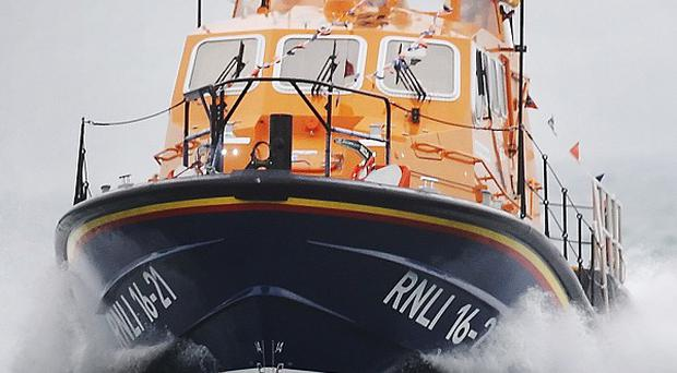 An RNLI lifeboat joined a sea search after two unattended fishing rods were found on rocks at Portrush