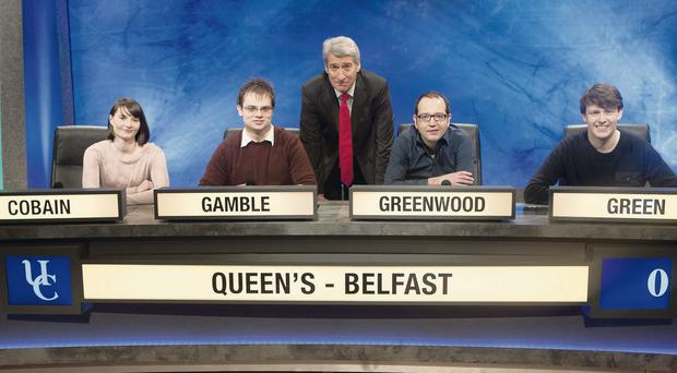 The Queen's University team of Suzanne Cobain, Gareth Gamble, Joseph Greenwood and Alexander Green with University Challenge host Jeremy Paxman