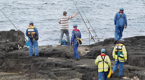 Coastguard land and sea searches at the Blue Pool area of Portrush in Co-Antrim. The rods and fishermen in photo are not connected to the search.