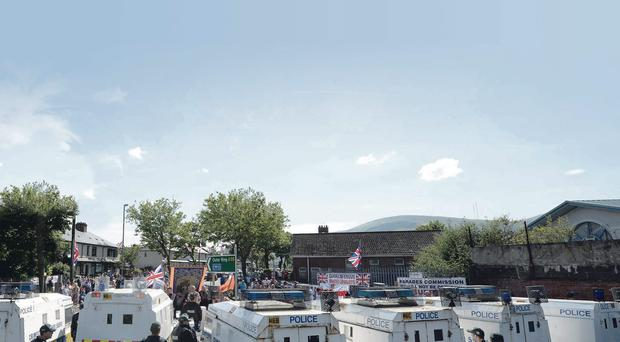 Loyalists hold a white line protest at interface area Twaddell Avenue
