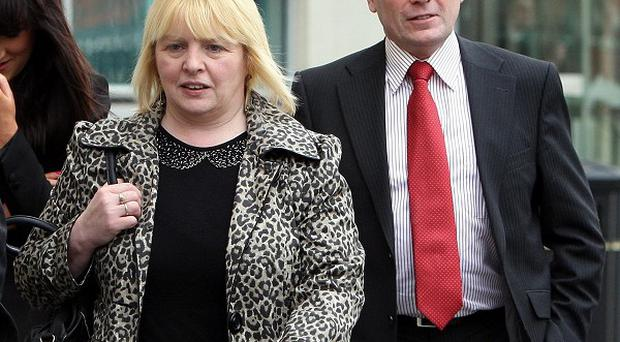 Sally Gribben, sister of Martin McCaughey, and Philip O'Neill, brother in law of Desmond Grew, attended an inquest into their deaths in Belfast last year