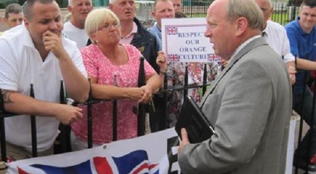 Traditional Unionist Voice leader Jim Allister, right, addresses loyalist protesters outside Stormont's Parliament Buildings