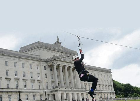 Mark H Durkan doing a zip line challenge for Action Mental Health
