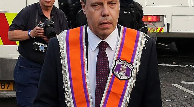Nigel Dodds was knocked unconscious as he tried to calm the sectarian violence erupting on the streets of his constituency