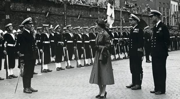 The Queen inspects naval troops at Guildhall Square