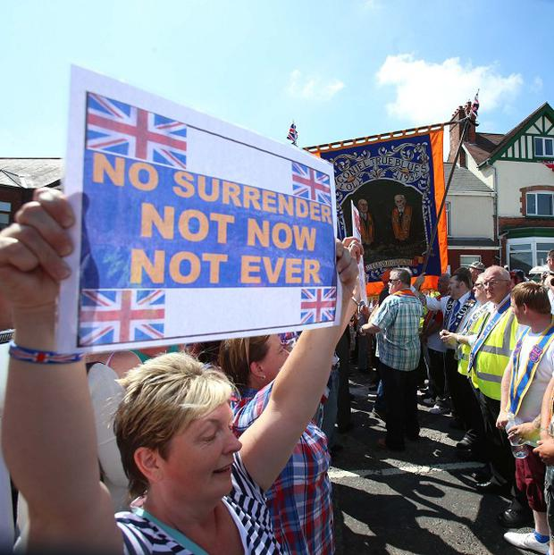A ban on a second application to parade past Ardoyne last weekend resulted in a peaceful protest by Orangemen and their supporters on the Woodvale Road