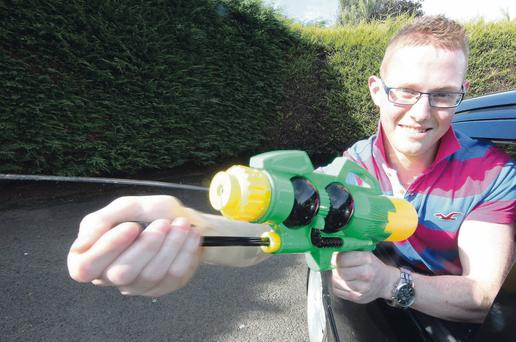 Philip with his plastic water pistol