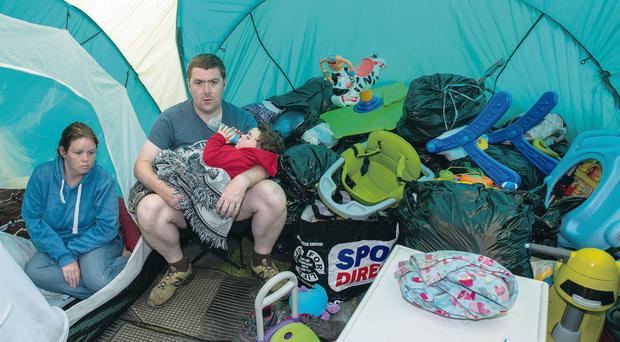 Paul Fisher and Audrey Buchanan in tent with son Ethan