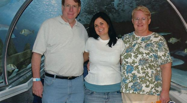 Courtney Hardy (centre) with her parents Ken (left) and Nancy Hardy