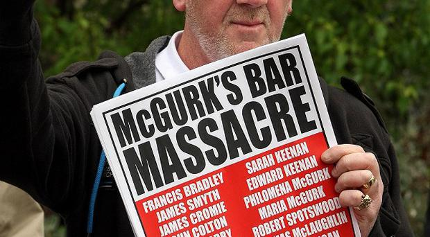 Relatives of those killed in the McGurk's bar bombing are to launch a legal bid to obtain a report