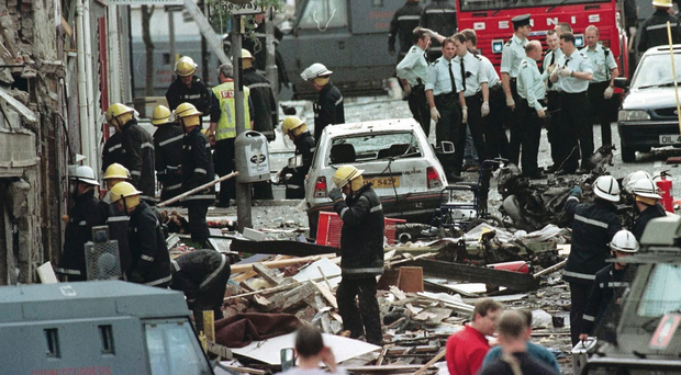 Firefighters and police officers search the rubble in the aftermath of the Omagh bombing in 1998