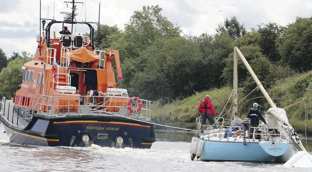 Portrush lifeboat tows the stricken yacht on the River Bann