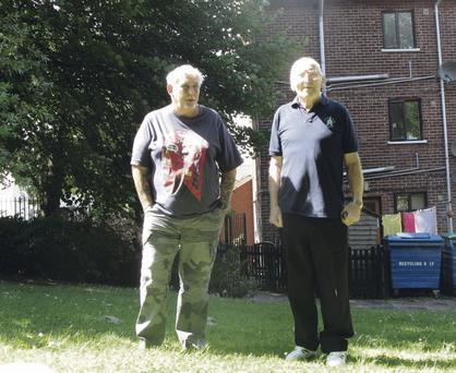 Brian Steeson and Sam Ritchie standing in one of the few spots where the sun reaches the ground because of overgrown trees near their flats