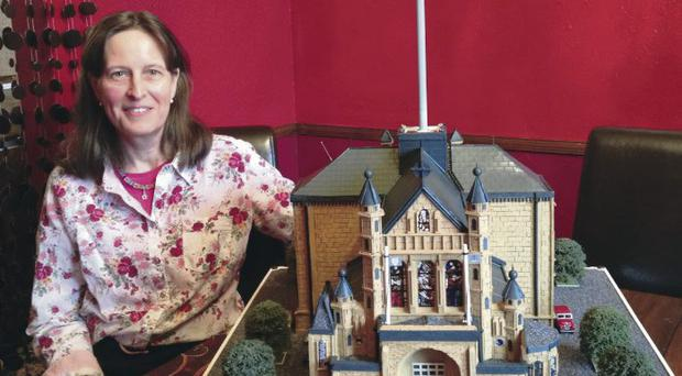 Lorraine McCarthy with her model of St Anne's Cathedral