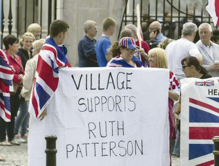 Loyalist flag protesters show their support for DUP member Ruth Patterson at City Hall on Saturday